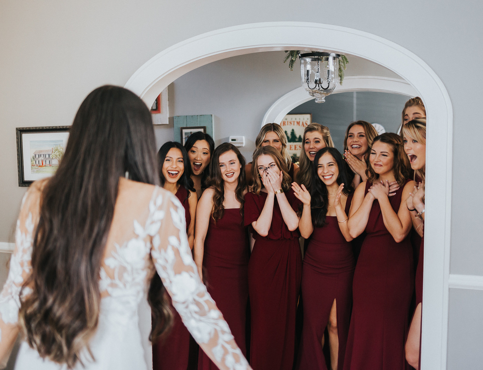 Tampa Bay Bride and Bridesmaids First Look, Florida Bride Wearing BHLDN Long Sleeve Wedding Dress, Bridesmaids in Long Mismatched Wine Burgundy Dresses From BHLDN