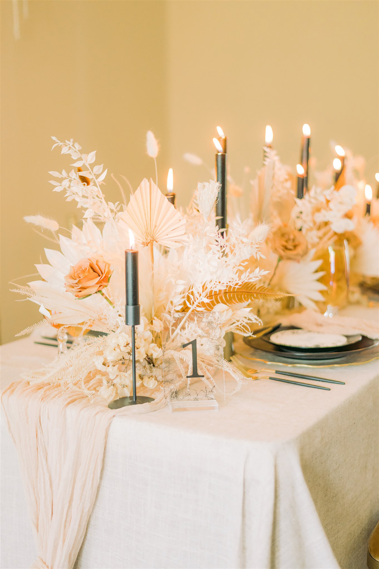 Trendy Modern Boho Wedding Reception Tablescape Decor, Dried Preserved Flower Bouquets, White Feathers, Foliage, Black Taper Candlesticks, Black Chargers, Black and Gold Silverware, White Linens, Custom Stationery | Tampa Bay Wedding Planning, Stationery, Design, Florals John Campbell Weddings | Tabletop Wedding Rentals Kate Ryan Event Rentals | Styled Shoot