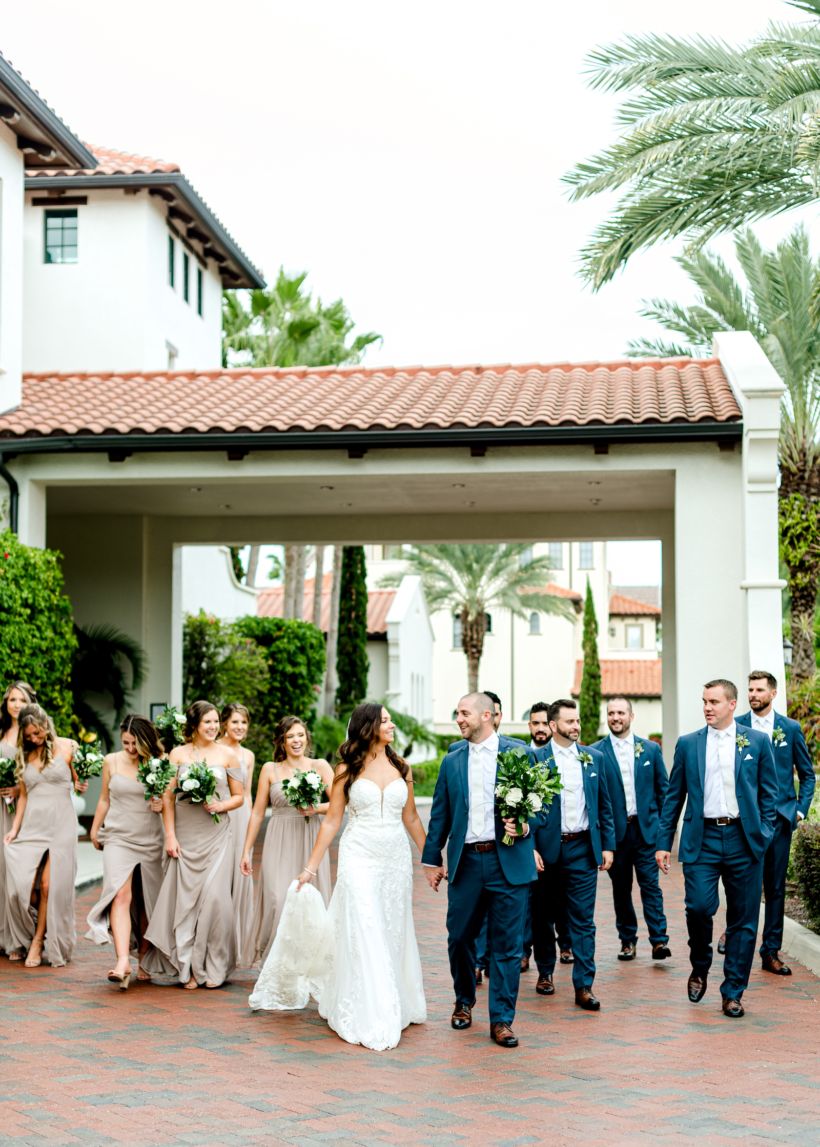 Wedding Party Outdoor Portrait at Tampa wedding Venue Westshore Yacht Club | Lace Strapless Sweetheart Scalloped Edge Train Wedding Dress Bridal Gown | Groom and Groomsmen Wearing Classic Navy Suit | Long Chiffon Taupe Champagne Neutral Bridesmaid Dresses by Lulu's | Dewitt for Love Photography