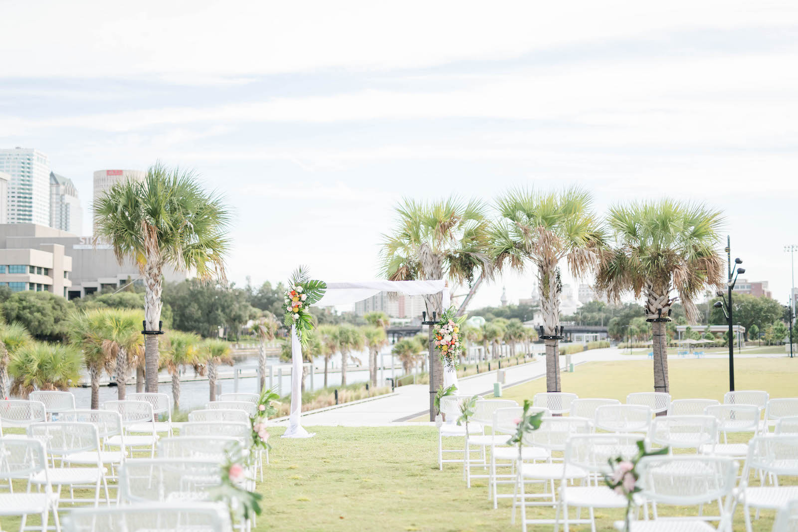 Tropical Outdoor Wedding Ceremony Decor, Arch with Monstera Palm Leaves Colorful Flower Arrangements | Tampa Bay Wedding Planner Coastal Coordinating