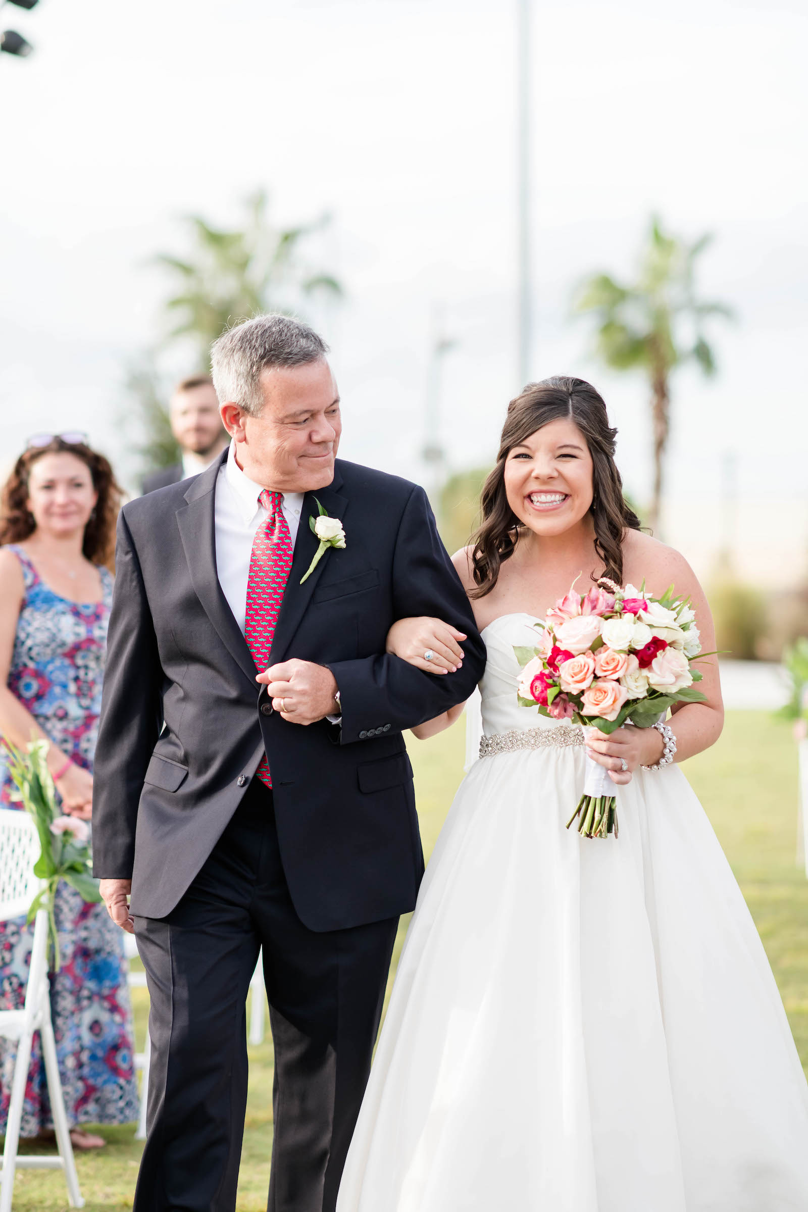 Happy Emotional Bride Walking Down the Wedding Ceremony Aisle with Father in Strapless A-Line Wedding Dress with Pink and White Roses Floral Bouquet | Tampa Bay Wedding Hair and Makeup Adore Bridal | Blogger Girl Meets Bow