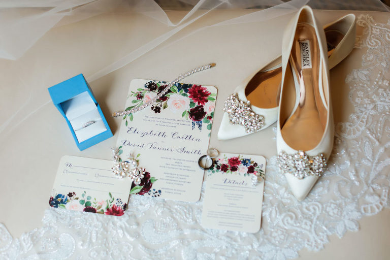 Wedding Accessories Shot with Designer Badgley Mischka Bridal Flat Shoes with Rhinestone Buckle | Watercolor Floral Wedding Invitation with Blush Pink and Berry Roses and Calligraphy
