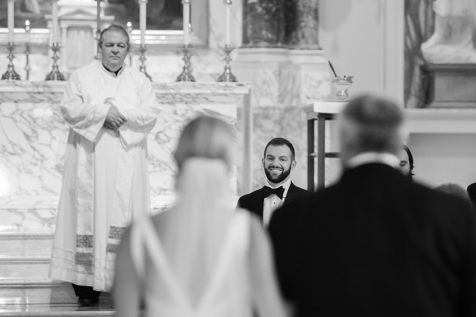 Groom Looking at Bride Walking down Aisle with Father during Traditional Church Wedding Ceremony in Tampa