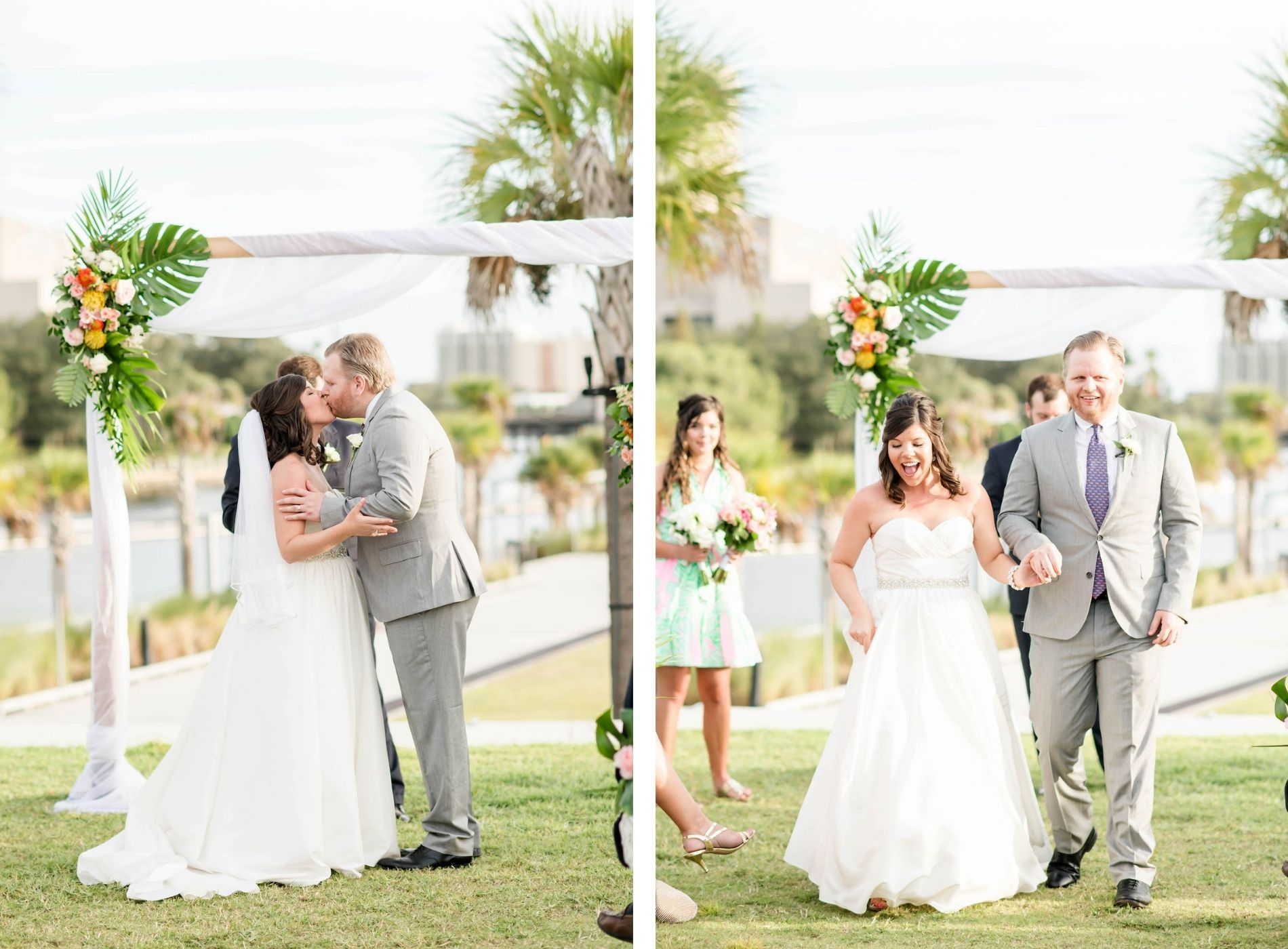 Florida Tropical Bride and Groom Exchanging First Kiss During Wedding Ceremony, Arch with White Linens and Monstera Leaves, Pink, Yellow and White Floral Arrangements | Tampa Bay Wedding Planner Coastal Coordinating | Wedding Hair and Makeup Adore Bridal