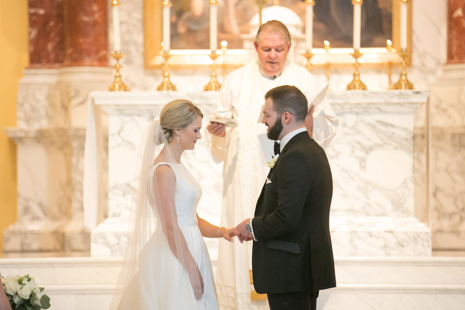 Bride and Groom Exchanging Vows during Traditional Church Wedding Ceremony in Tampa