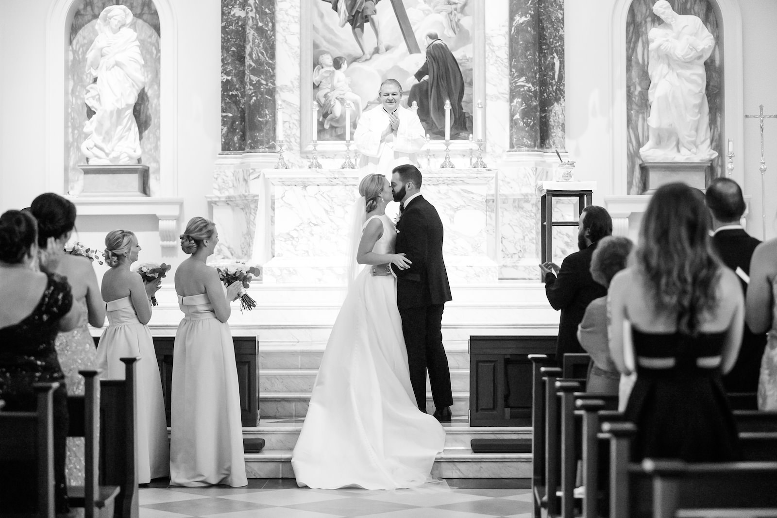 Black and White Wedding Photography | Bride and Groom First Kiss during Traditional Church Wedding Ceremony in Tampa