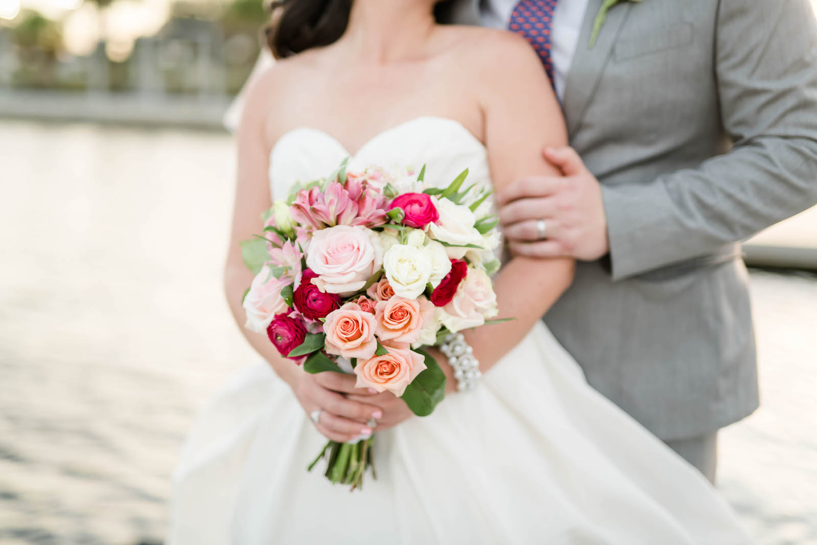 Tampa Bay Bride Holding Blush, Magenta Pink and White Floral Bouquet