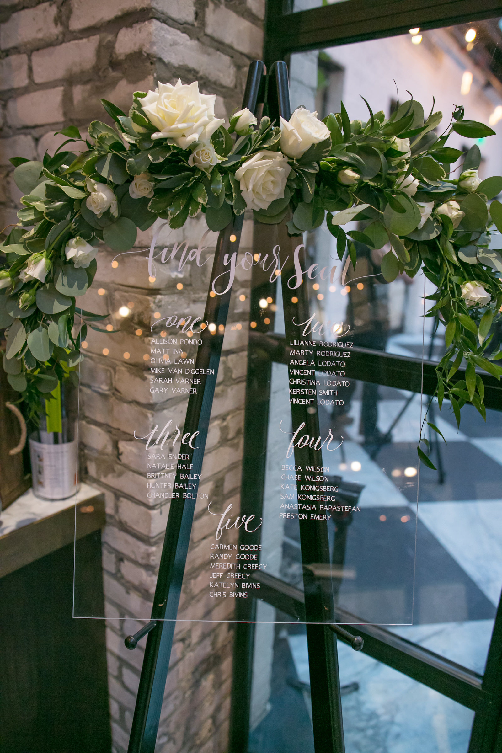 Wedding Seating Chart Acrylic Clear with White Calligraphy on Easel with Greenery Garland