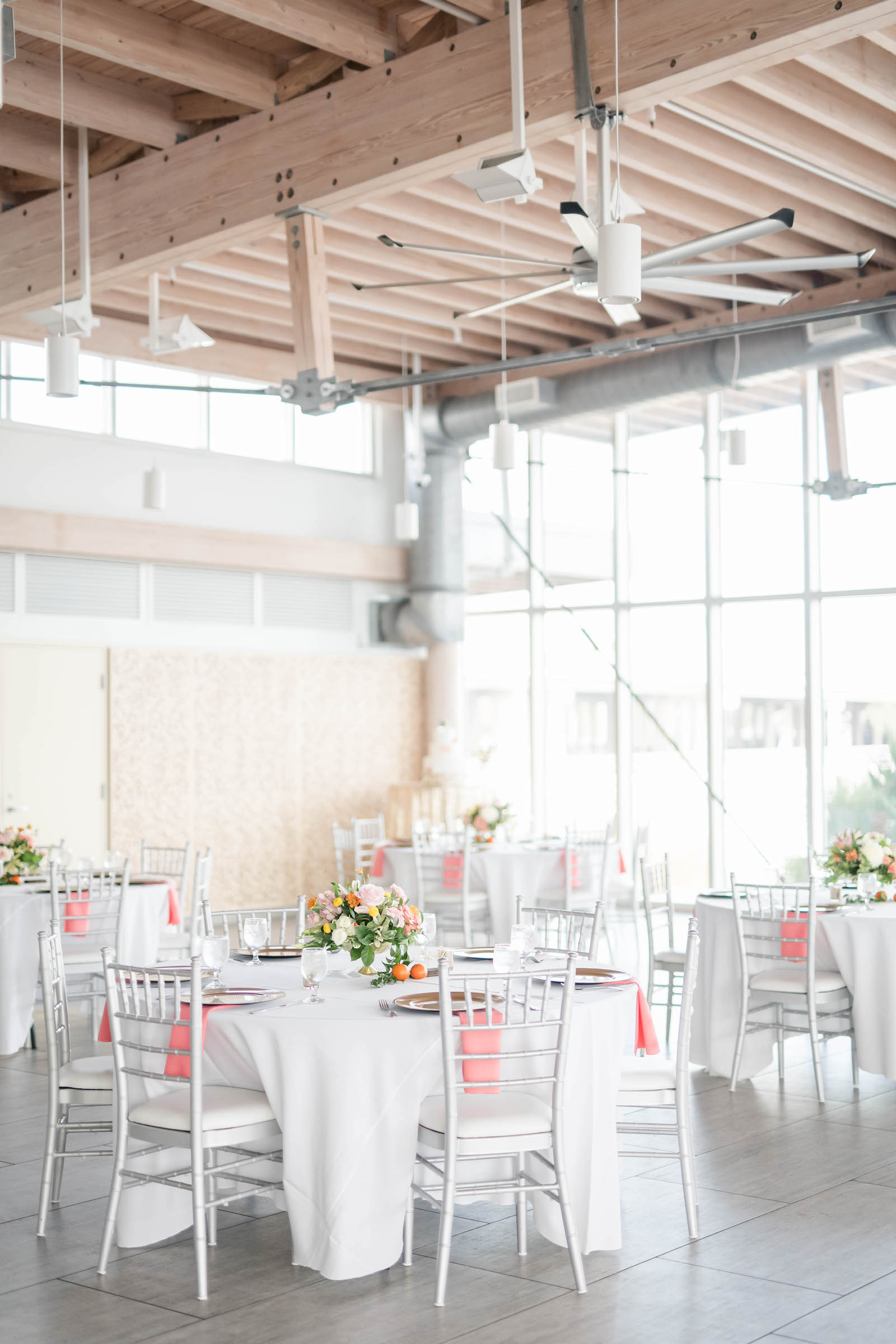 Tropical Wedding Reception Decor, Silver Chiavari Chairs, Pink Linen Napkins | Light and Airy Wedding Venue Tampa River Center | Tampa Bay Wedding Planner Coastal Coordinating