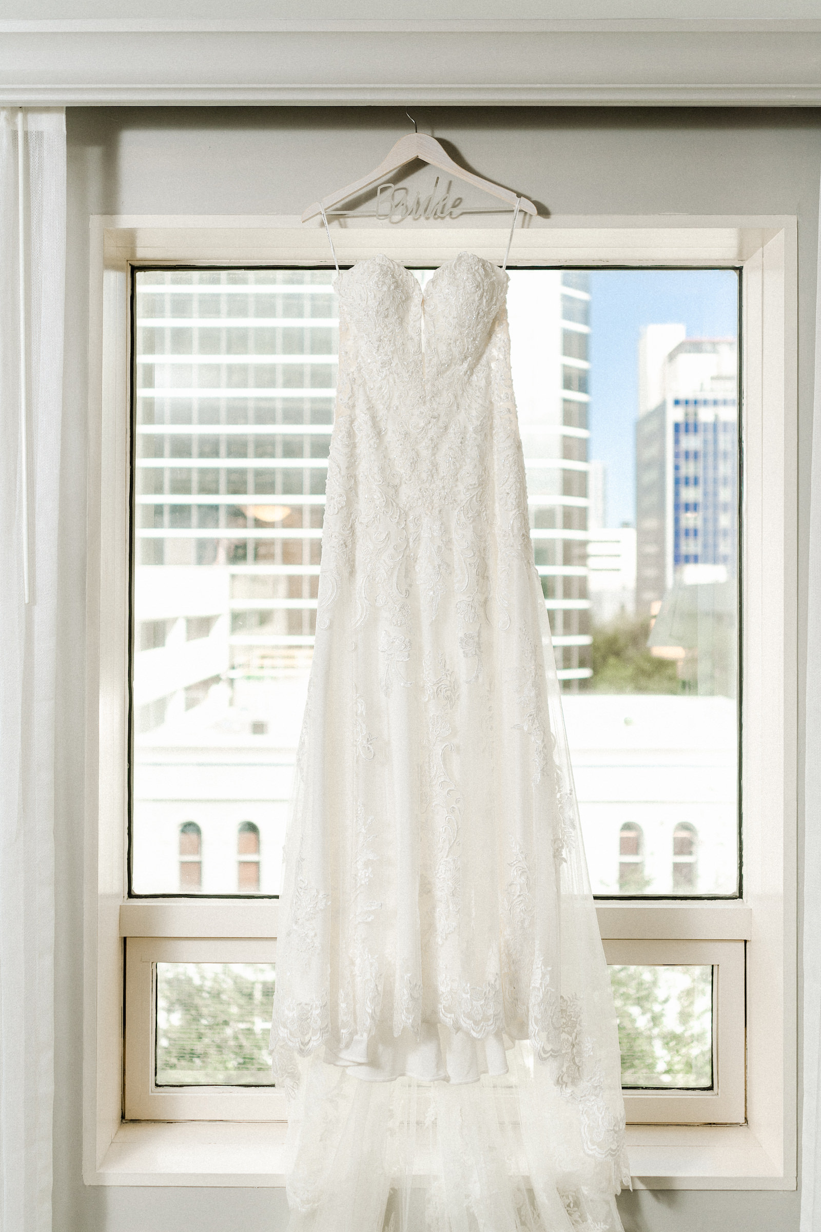 Wedding Dress Hanger Shot | White Lace Sweetheart Neckline Strapless Sheath Wedding Dress Bridal Gown Hanging in Window