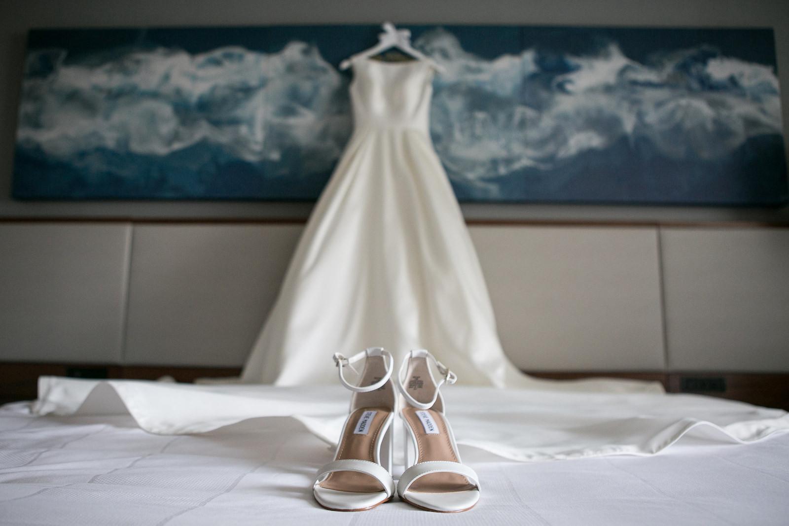 Wedding Dress Hanger Shot | Bateau Neck Mikado Satin Martina Liana Simple Elegant Wedding Dress with Ivory Strappy Steve Madden Heels