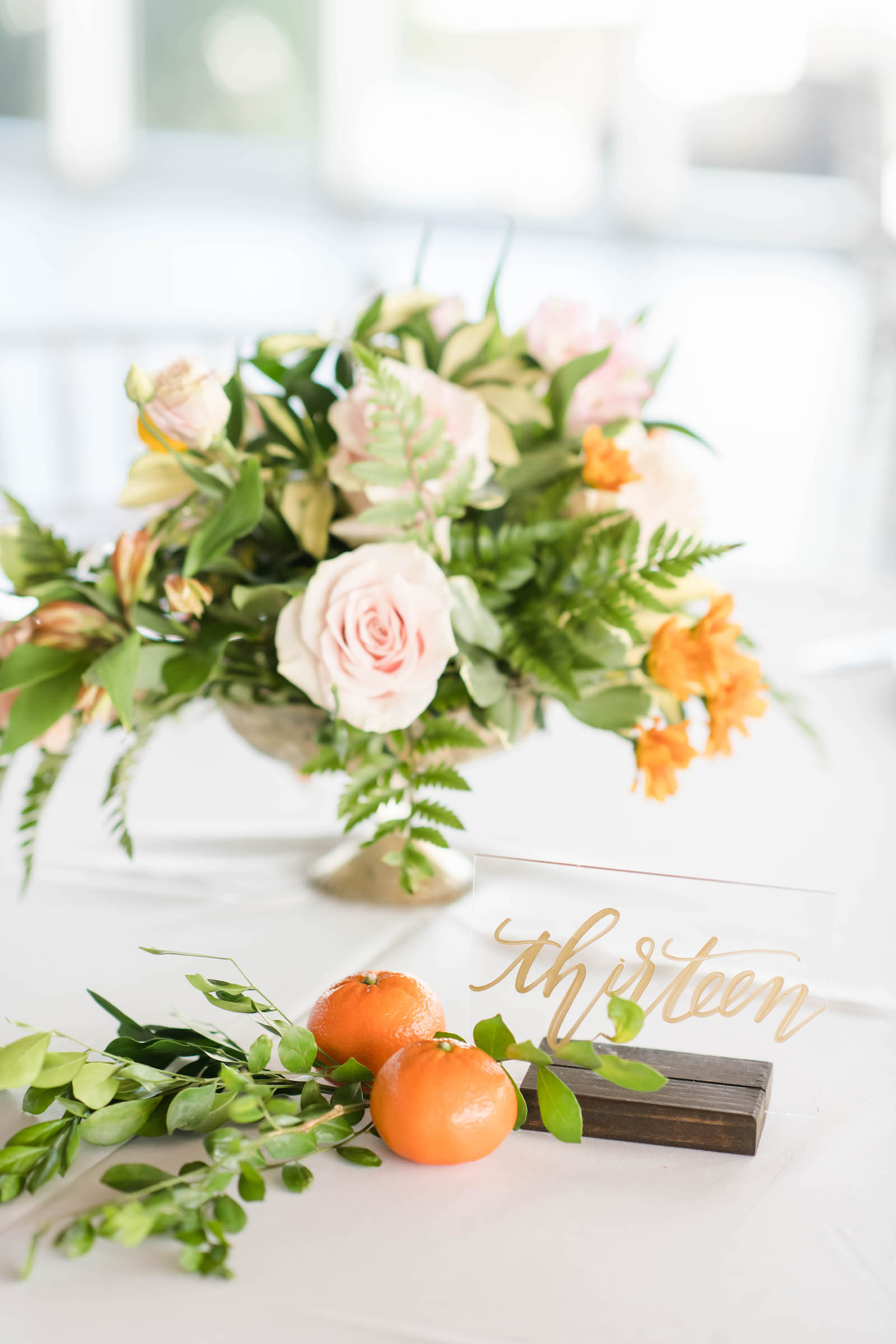 Tropical Wedding Reception Decor, Low Floral Centerpiece, Blush Pink and Orange Flowers, Greenery, Tangerine Fruits and Acrylic with Gold Script Table Number | Tampa Bay Wedding Planner Coastal Coordinating