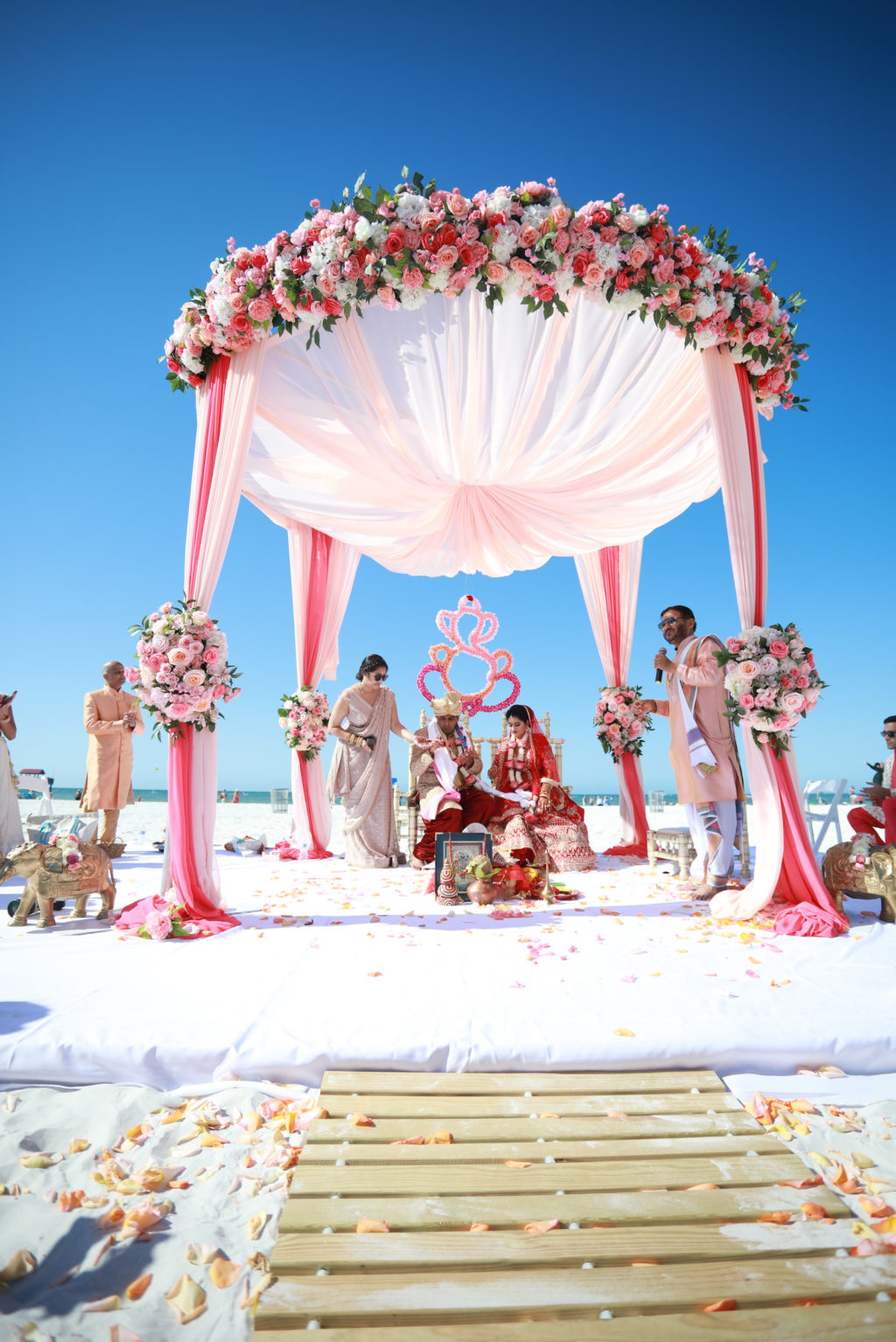 Tampa Clearwater Beach Indian Wedding Mandap with Pink and Coral Draping and Pink Peach Coral Roses