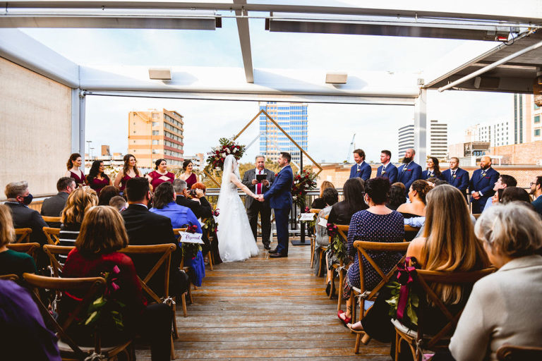 Bride and Groom Exchanging Wedding Vows During Rooftop Ceremony in Front of Geometric Sculpture   Tampa Bay Wedding Planner Special Moments Event Planning   St. Pete Wedding Venue Red Mesa Events
