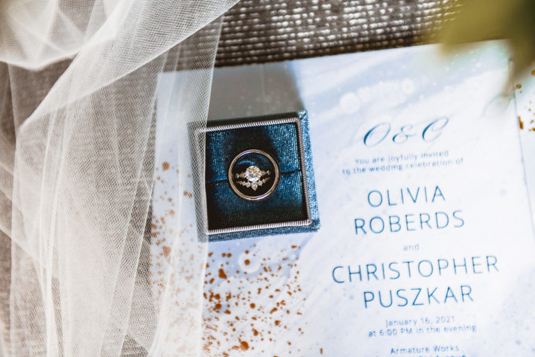 Round Diamond Solitaire Wedding Engagement Ring, Bride and Groom Wedding Bands in Blue Velvet Ring Box, Blue Watercolor and Gold Foil Splatter Wedding Invitation