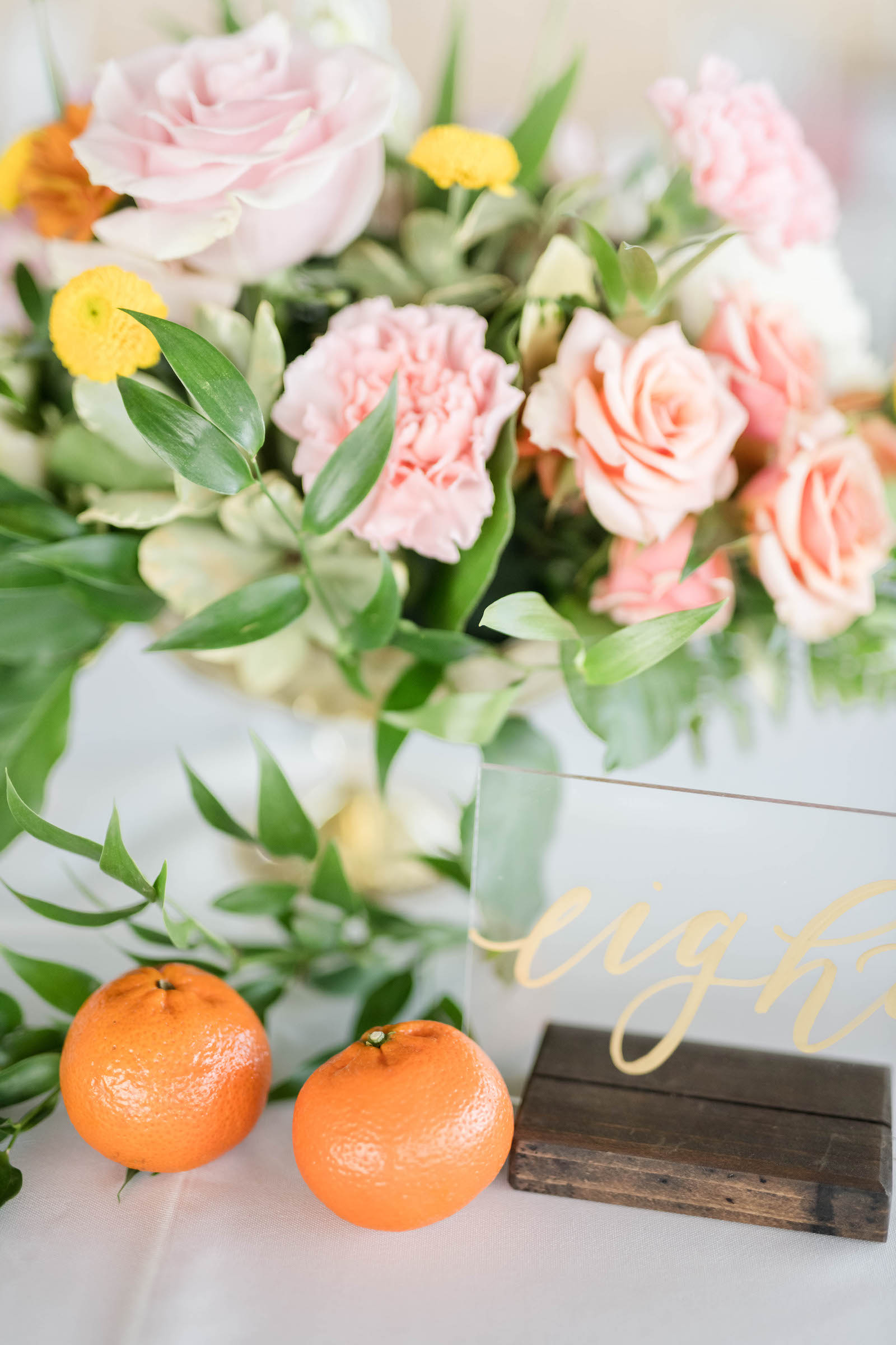 Tropical Wedding Reception Decor, Tangerine Oranges, Acrylic and Gold Script Table Number, Colorful Floral Bouquet with Pink, White and Orange Flowers | Tampa Bay Wedding Planner Coastal Coordinating