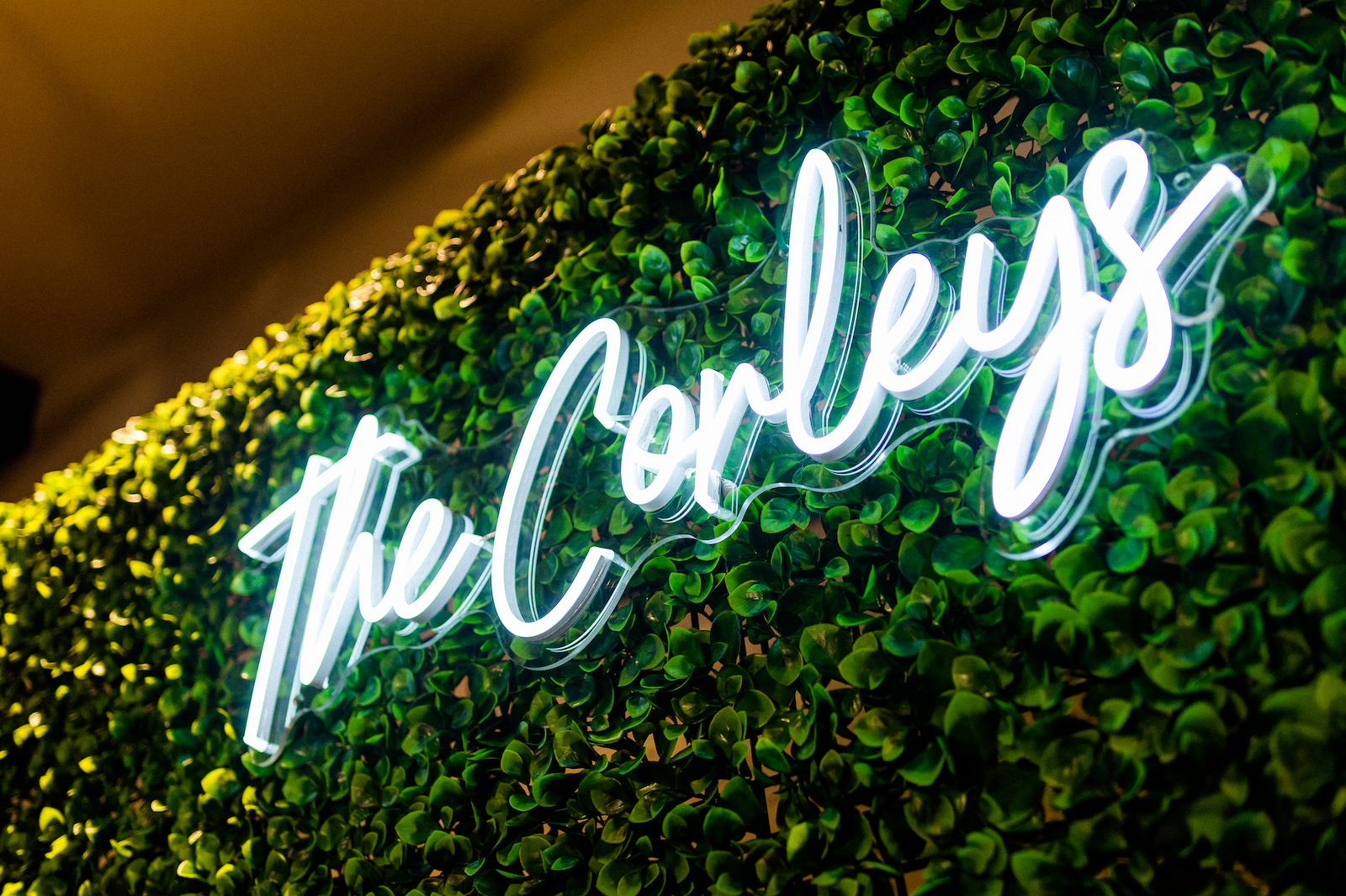 Wedding Neon Sign Couple's Last Name on Hedge Wall