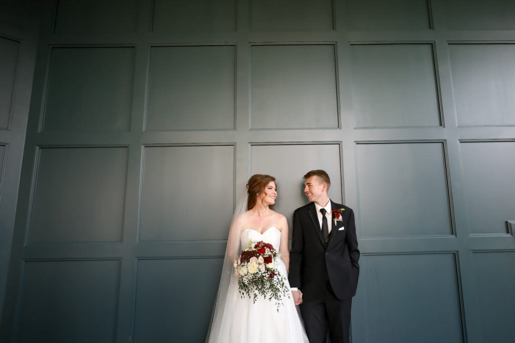 Bride and Groom Portrait | Groom Wearing Classic Black Suit Tux | Bride Wearing Organza Sweetheart Neckline Sincerity Bridal Gown Wedding Dress with Long Pearl Studded Cathedral Veil | Bridal Wedding Bouquet with Burgundy and White Hydrangea, Red Carnations, White Roses, Baby's Breath and Greenery | Lifelong Photography Studio