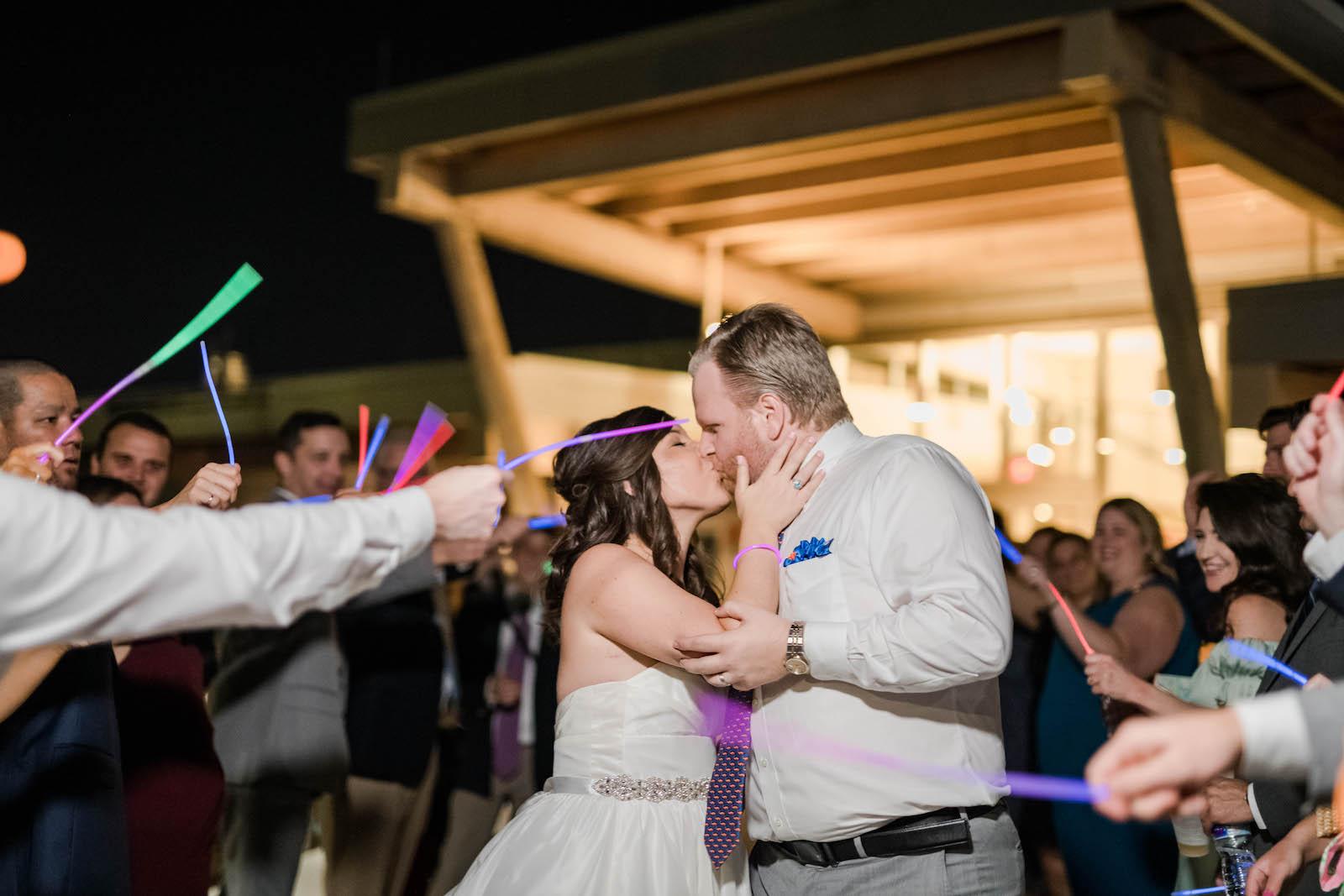 Fun Bride and Groom Glow Sticks Wedding Exit Photo