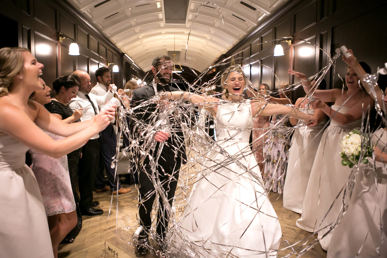 Bride and Groom Exit in Silver Confetti Streamer Send Off at Reception in Downtown Tampa | Bateau Neck Mikado Satin Martina Liana Simple Elegant Wedding Dress with Buttons Down Back | Groom in Classic Black Tux | Carrie Wildes Photography