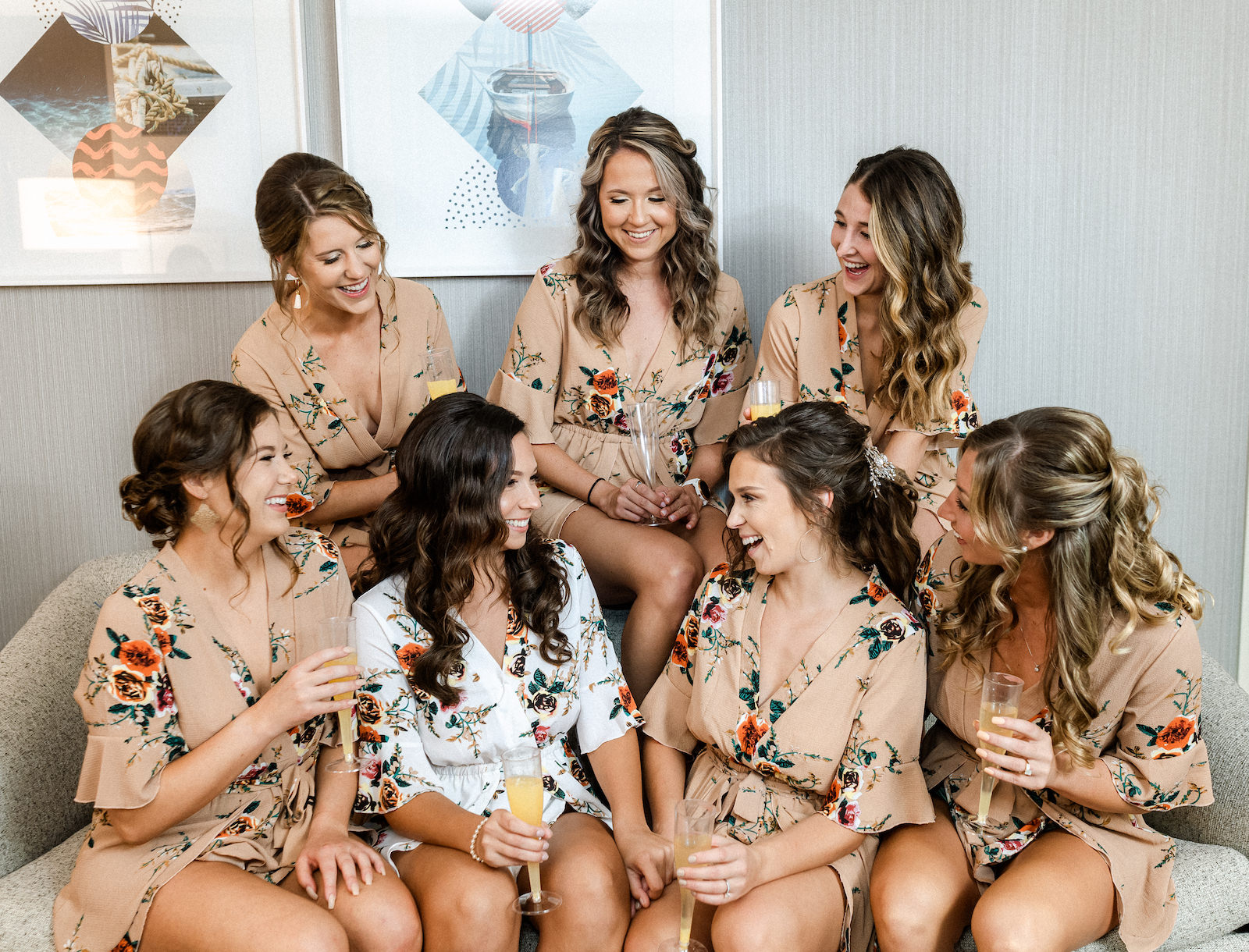 Bride and Bridesmaids Getting Ready in Champagne and White Floral Robes with Bottle of Champagne Bubbly | Dewitt for Love Photography