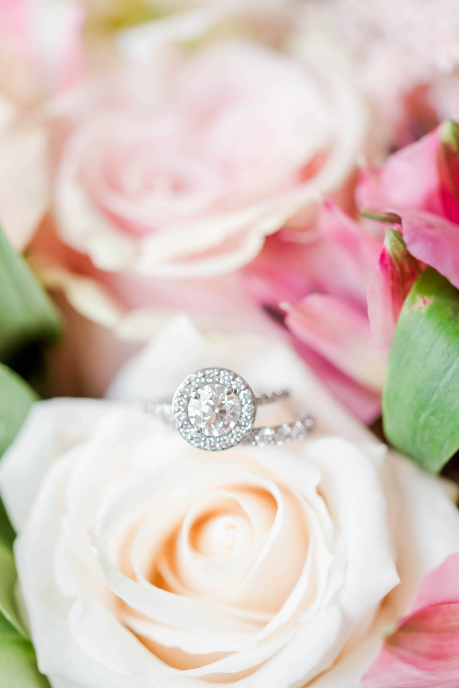 Round Solitaire Diamond and Halo Engagement Ring