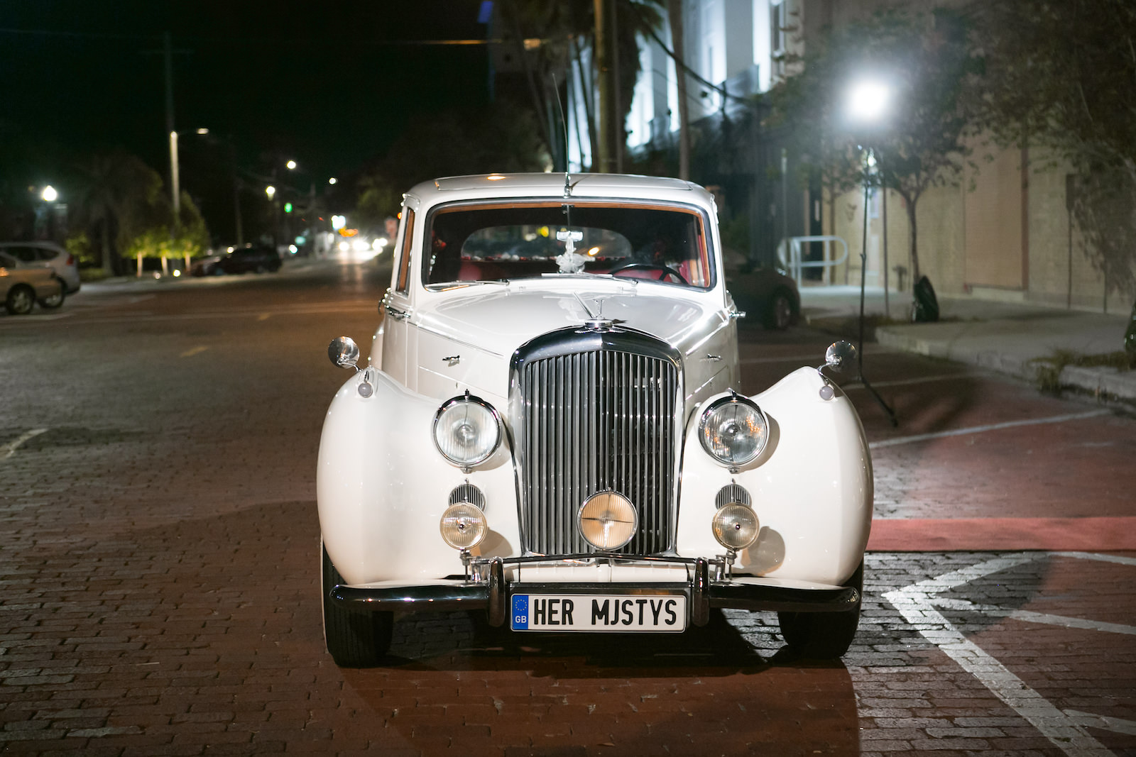 Bride and Groom Exit in Classic Car Vintage Rolls Royce White Bentley