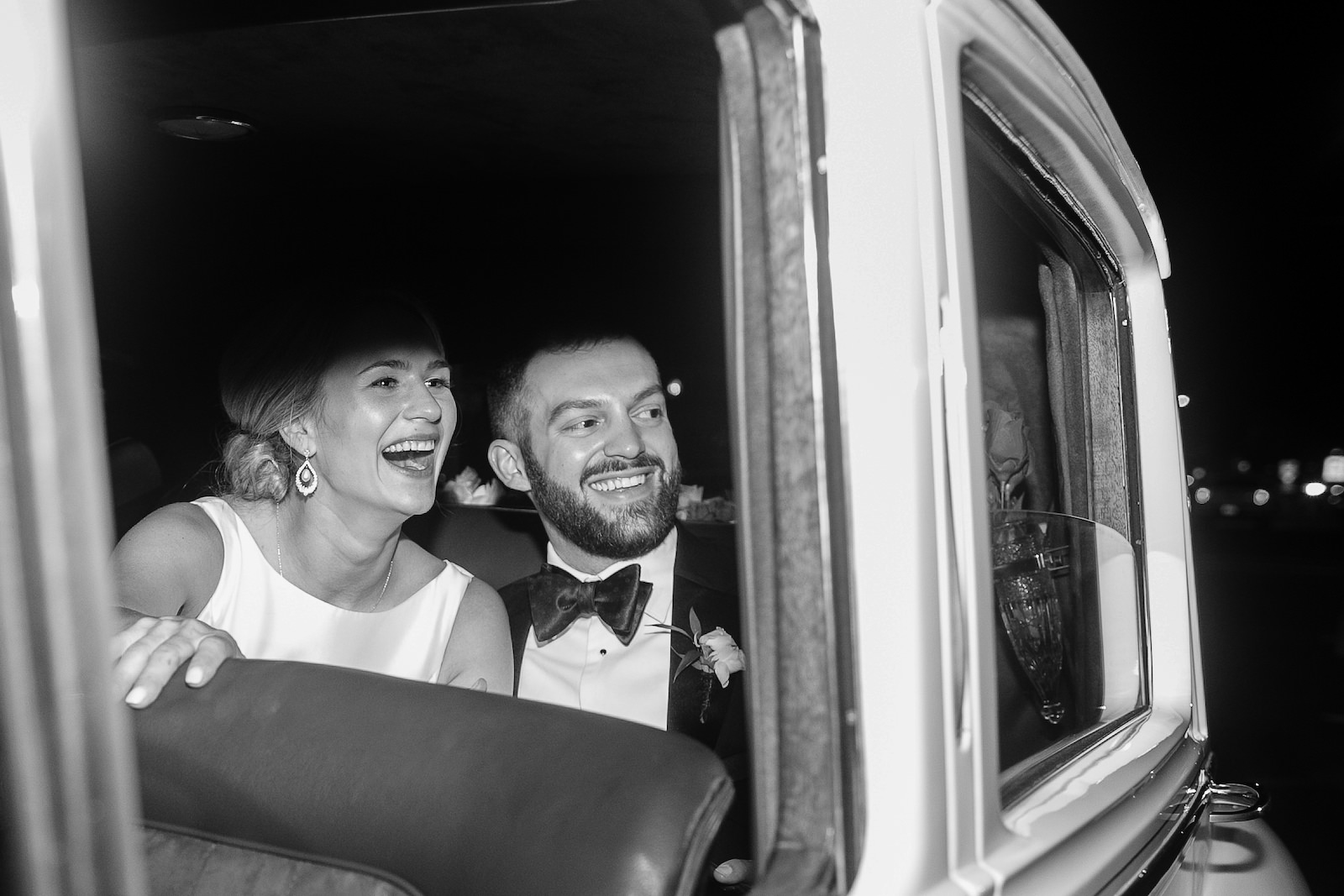 Black and White Wedding Photography | Bride and Groom Exit in Classic Car Vintage Rolls Royce White Bentley