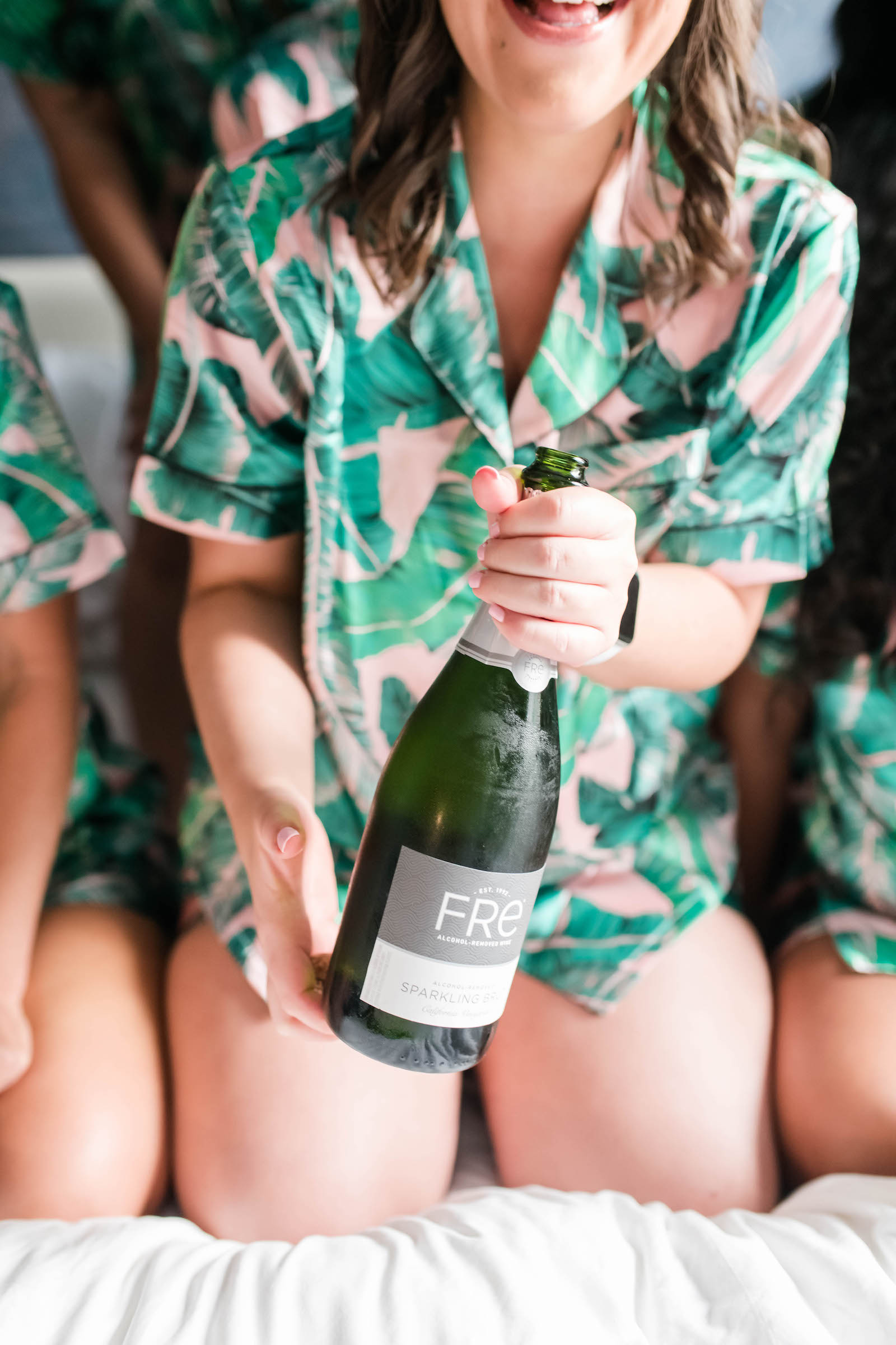Tampa Bride in Tropical Pajamas Popping Bottle of Champagne