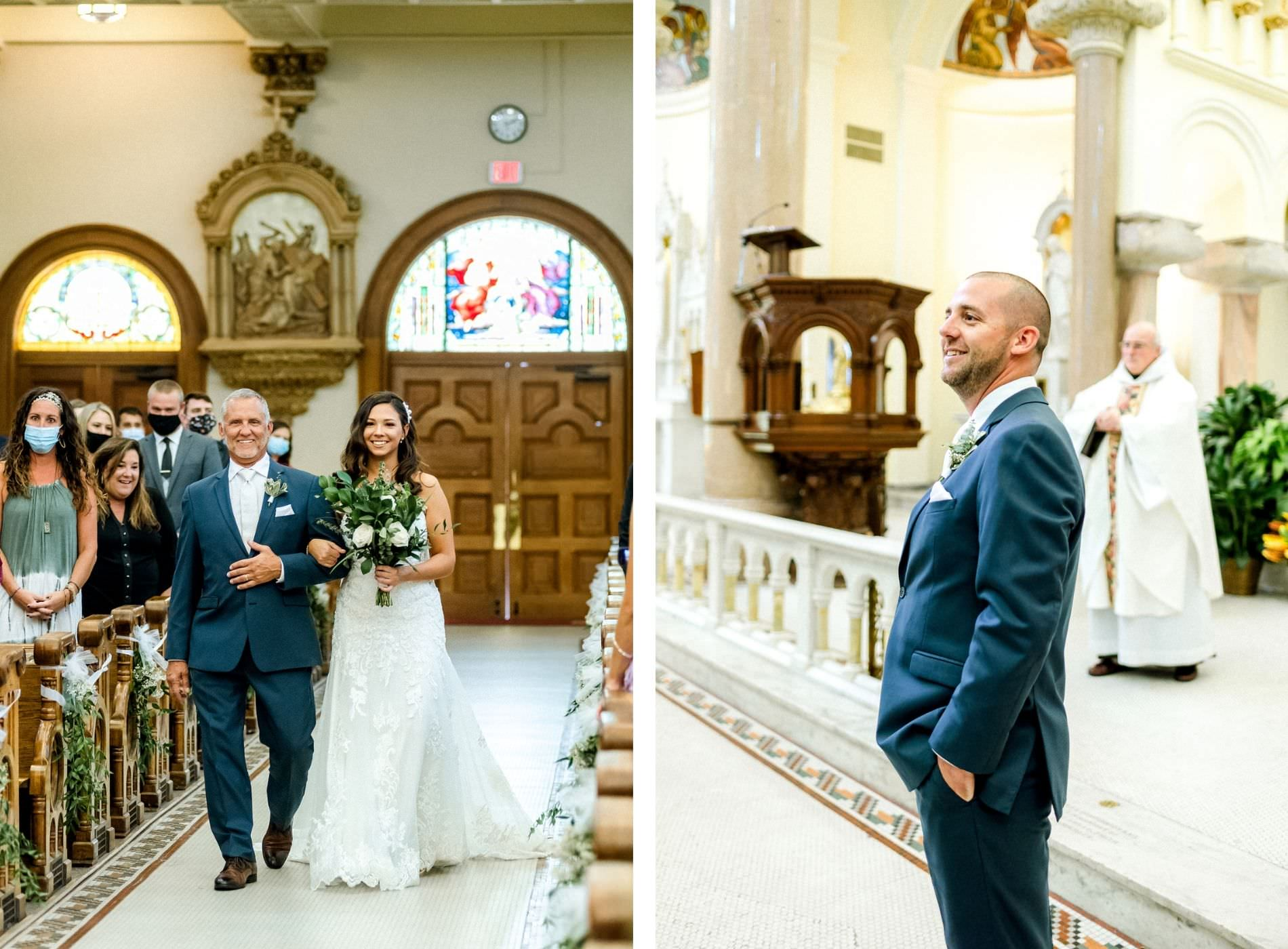 Bride Walking Down Aisle with Father during Downtown Tampa Wedding Ceremony at Sacred Heart Catholic Church | Church Ceremony Aisle with Greenery | Father of the Bride and Groom Wearing Classic Navy Suit