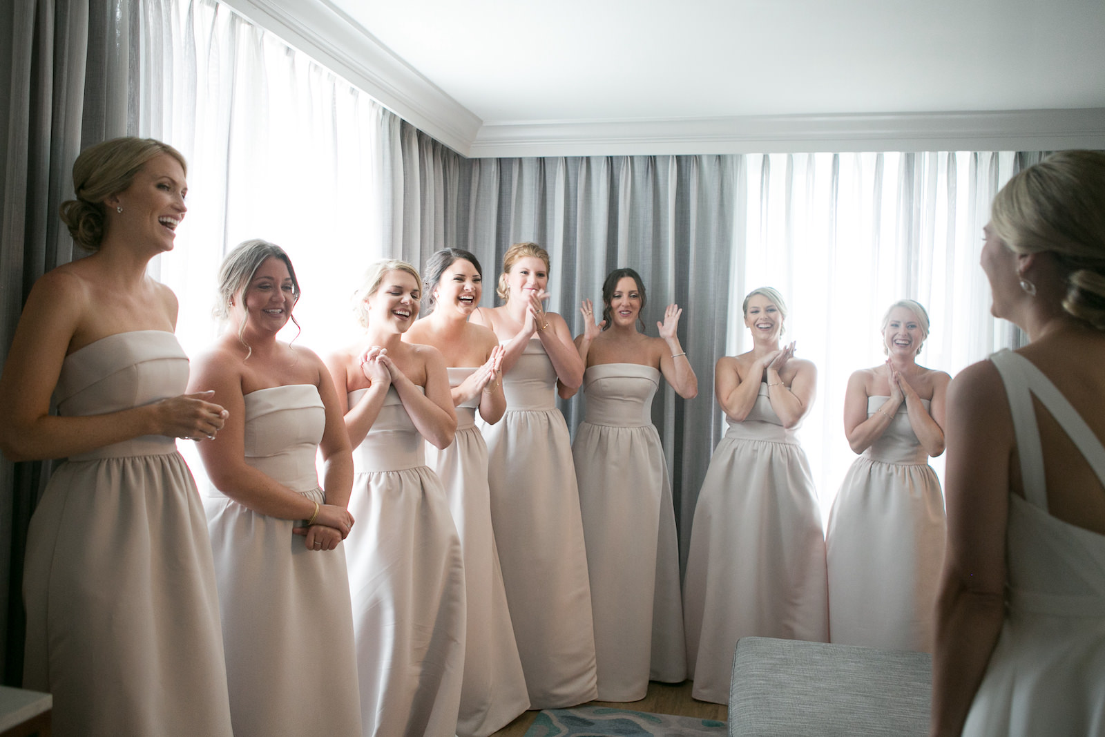 Bride First Look with Bridesmaids | Strapless Taupe Neutral Bridesmaid Dresses by Amsale | Carrie Wildes Photography