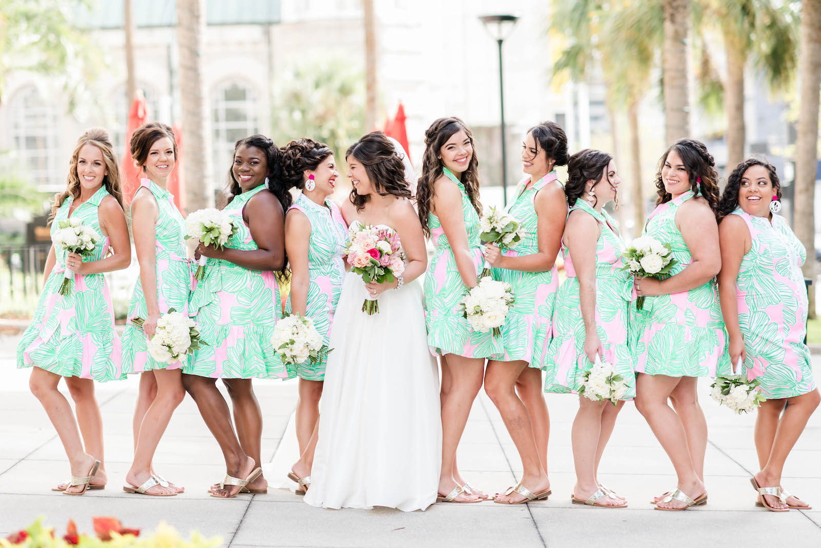 Tropical Bride and Bridesmaids in Matching Pink and Seafoam Green Short Dresses Holding White Floral Bouquets | Tampa Bay Wedding Hair and Makeup Adore Bridal | Blogger Girl Meets Bow