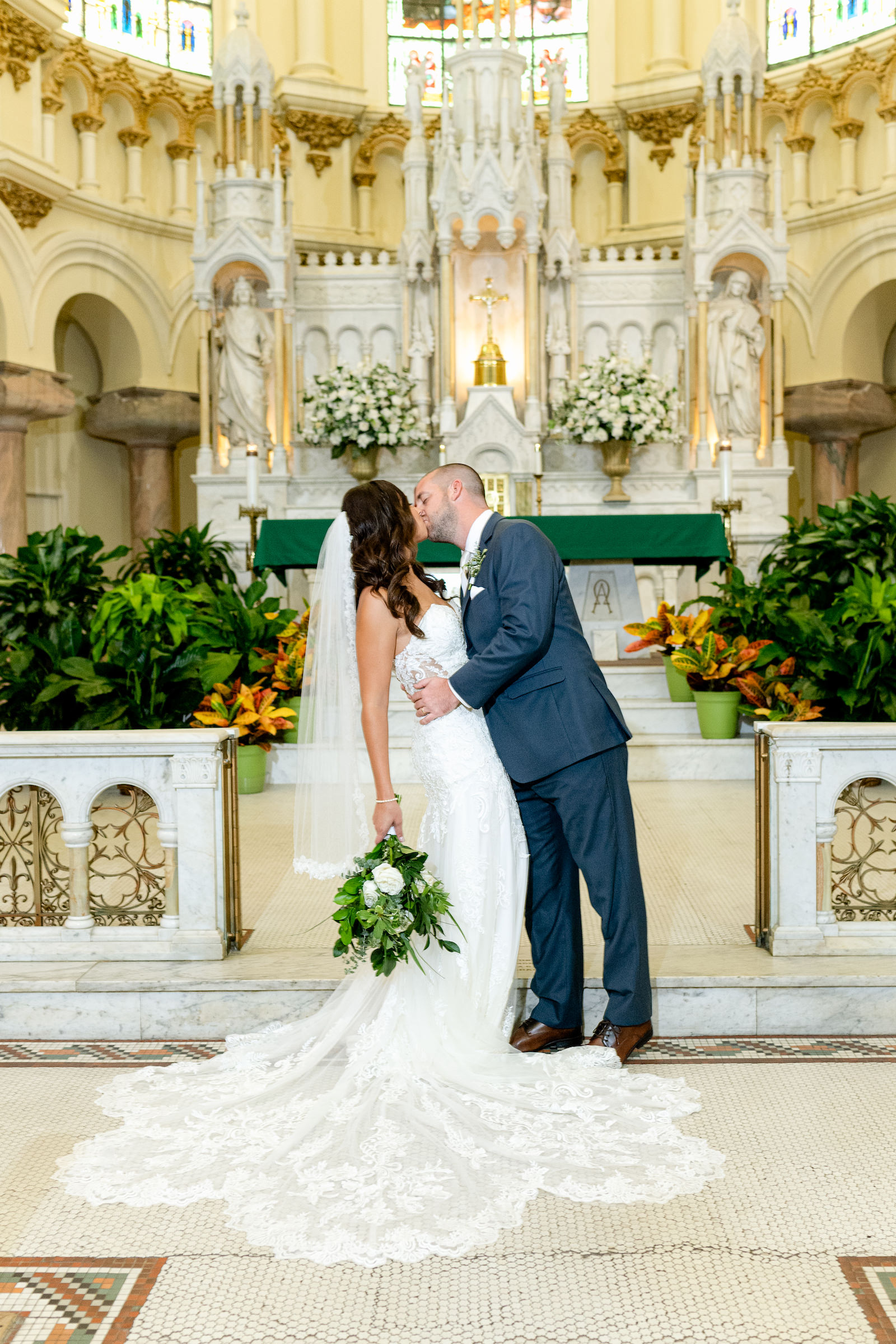 Bride and Groom Portrait at Sacred Heart Catholic Church | Lace Strapless Sweetheart Scalloped Edge Train Wedding Dress Bridal Gown | Groom Wearing Classic Navy Suit | Dewitt for Love Photography
