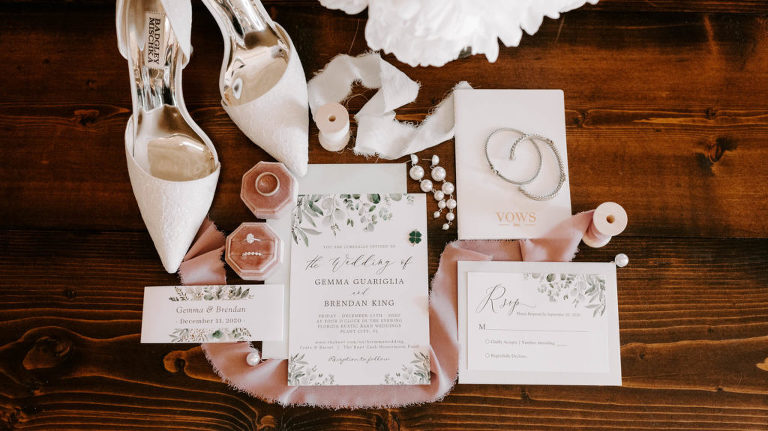 Tampa Wedding Invitation Suite Flat Lay Stationery with Greenery Motif | Blush Pink Velvet Ring Box with Bridal Accessories and Badgley Mischka Designer White Lace Pumps Bride Shoes
