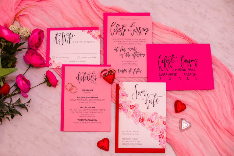 Valentine Inspired Pink and Red Stationery Wedding Invite Flat Lay