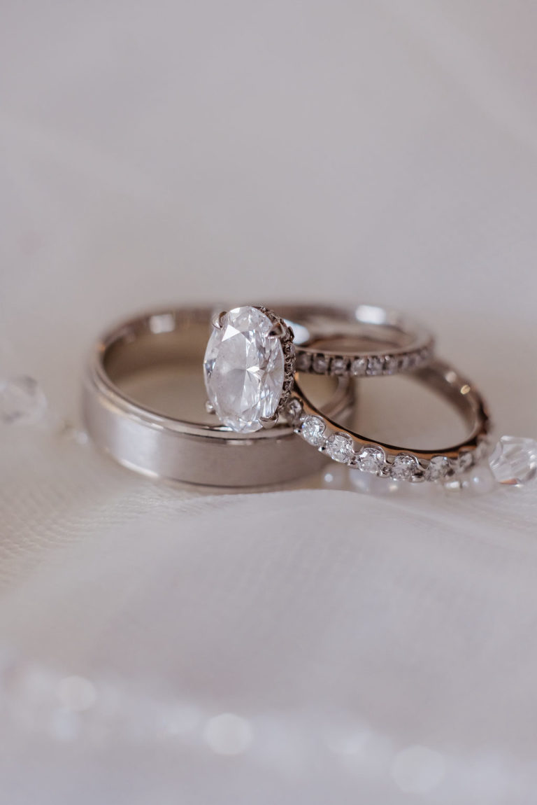 Oval Diamond Engagement Ring with Bride and Groom Wedding Bands