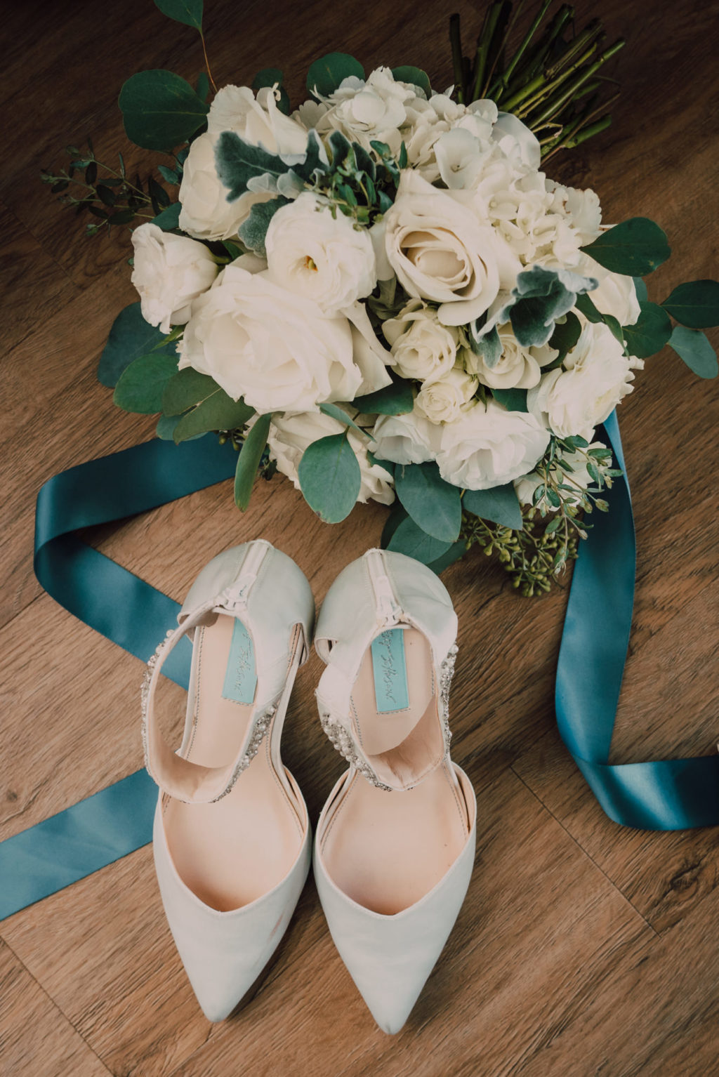 tampa wedding bouquet with white roses and eucalyptus greenery with betsey johnson designer bridal heels shoes