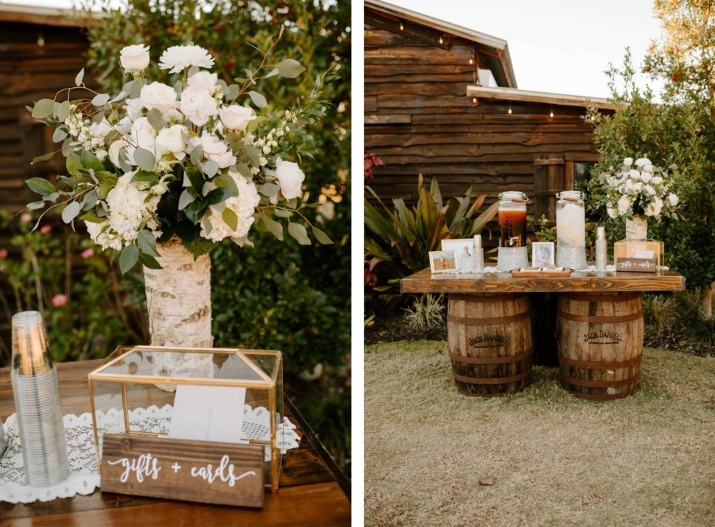 Florida Rustic Barn Wedding Beverage Station with Iced Tea and Water on Wood Barrel Table | Gold Geometric Glass Wedding Card Box with White Rose and Greenery Centerpiece Floral Arrangement