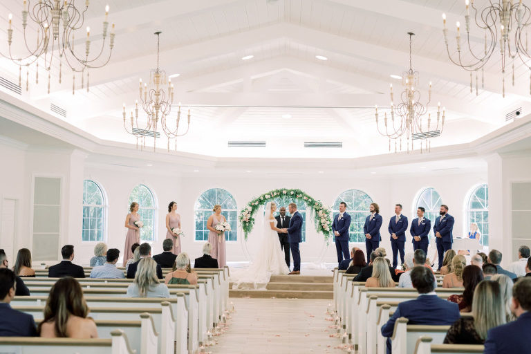 Florida Bride and Groom Exchanging Wedding Vows During Timeless Romantic Wedding Ceremony, Round Arch with Greenery and Blush Pink, Ivory Flowers | Tampa Bay Wedding Planner Special Moments Event Planning | Safety Harbor Traditional Wedding Venue Harborside Chapel