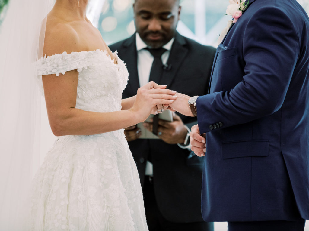 Florida Timeless Bride and Groom Exchanging Wedding Vows and Rings During Ceremony, Bride in Off the Shoulder Floral Lace Over Tulle Ballgown Wedding Dress
