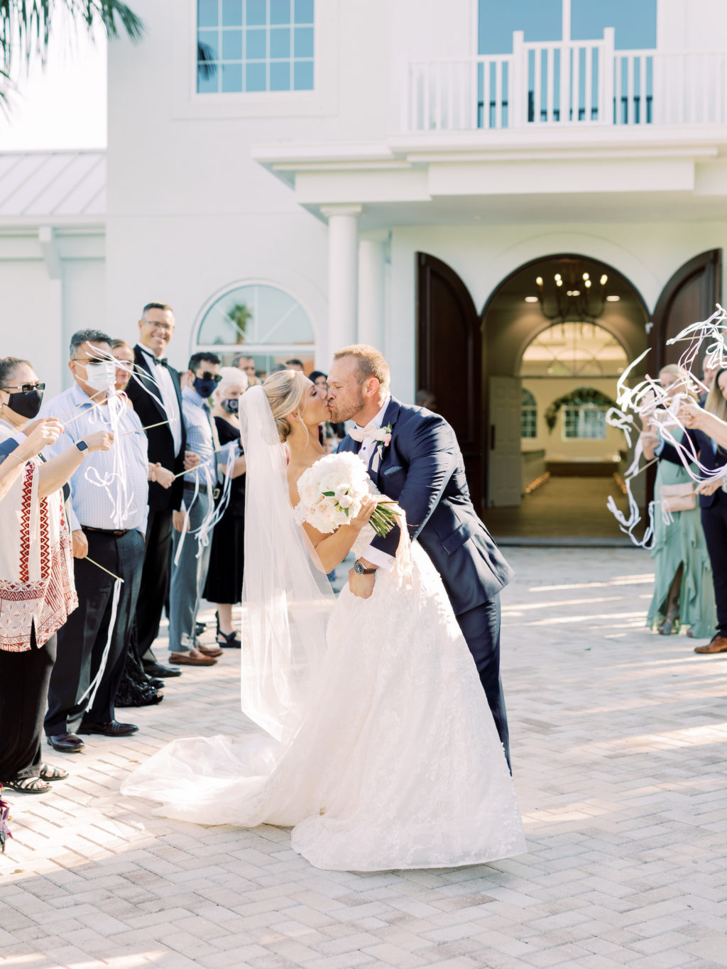Romantic Timeless Bride and Groom Kiss During Exit from Wedding Ceremony | Safety Harbor Traditional Wedding Venue Harborside Chapel