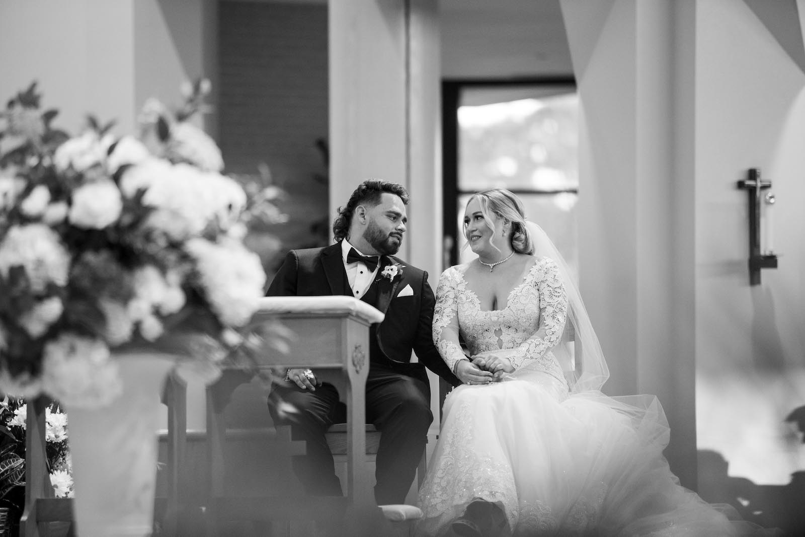Tampa Bride and Groom Exchanging Vows During Traditional Church Wedding Ceremony St. Jude's Cathedral | Wedding Planner Parties A'la Carte