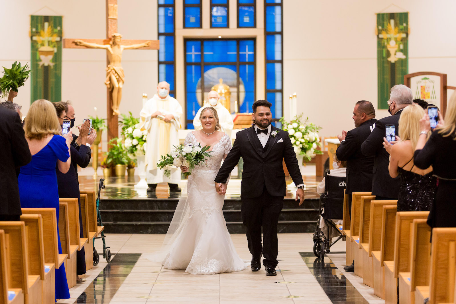 Tampa Bride and Groom Exiting Traditional Church Wedding Ceremony St. Jude's Cathedral | Wedding Planner Parties A'la Carte