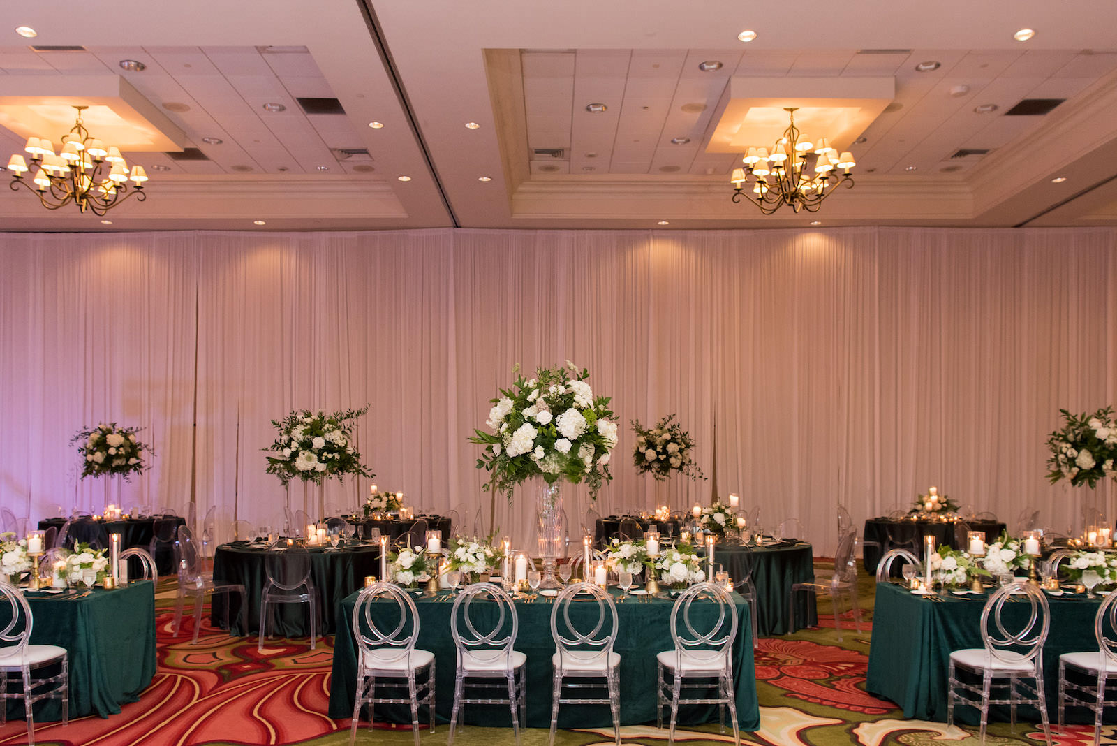 Elegant Wedding Reception Decor, Emerald Green Linens, Acrylic Chiavari Chairs, Tall White and Greenery Floral Centerpieces | Tampa Bay Wedding Planner Parties A'la Carte | Wedding Florist Bruce Wayne Florals | Table and Chair Rentals A Chair Affair | St. Pete Wedding Venue The Vinoy