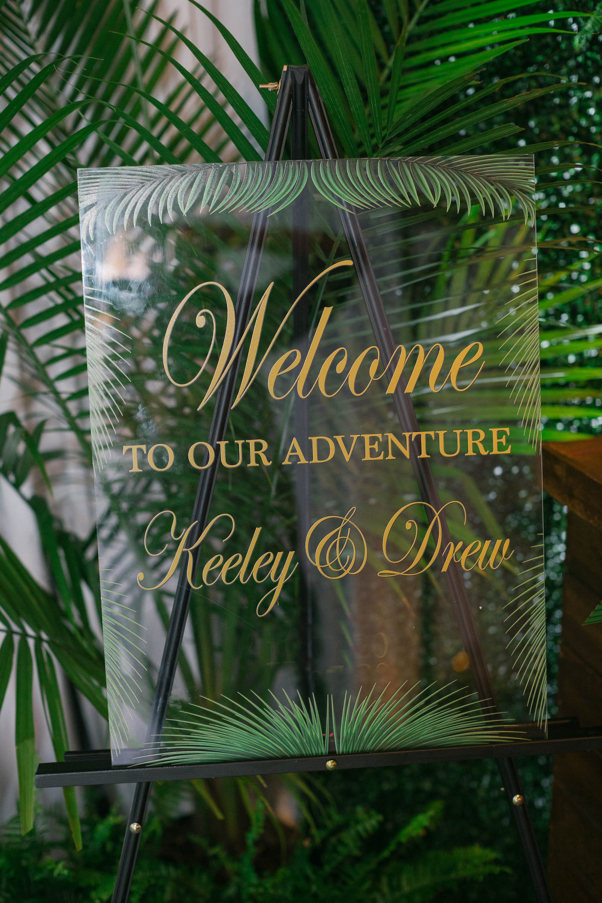 Tropical Destination Beach Wedding Inspiration Clear Acrylic Welcome Sign with Gold Lettering | Bellwether Beach Resort Styled with Love by Marry Me Tampa Bay
