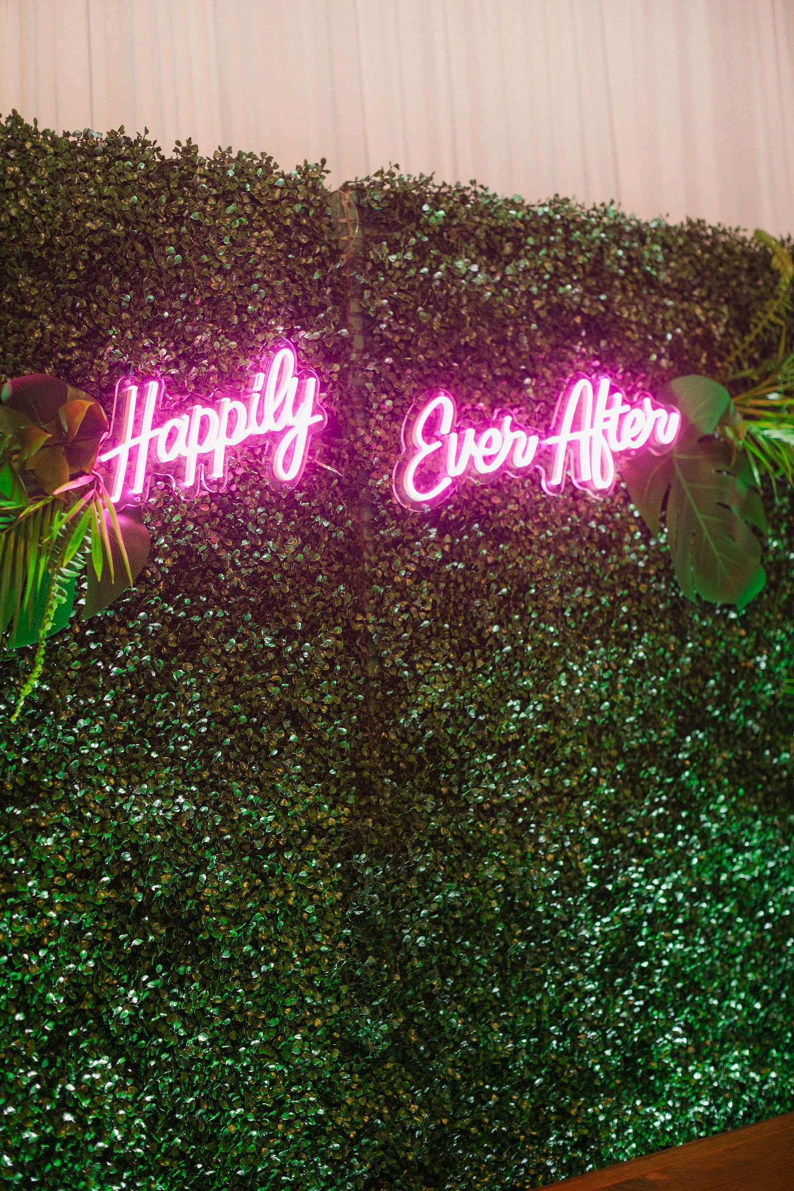 Greenery Boxwood Sweetheart Table Backdrop with Neon Happily Ever After Sign Tropical Destination Beach Wedding Inspiration   Bellwether Beach Resort Styled with Love by Marry Me Tampa Bay