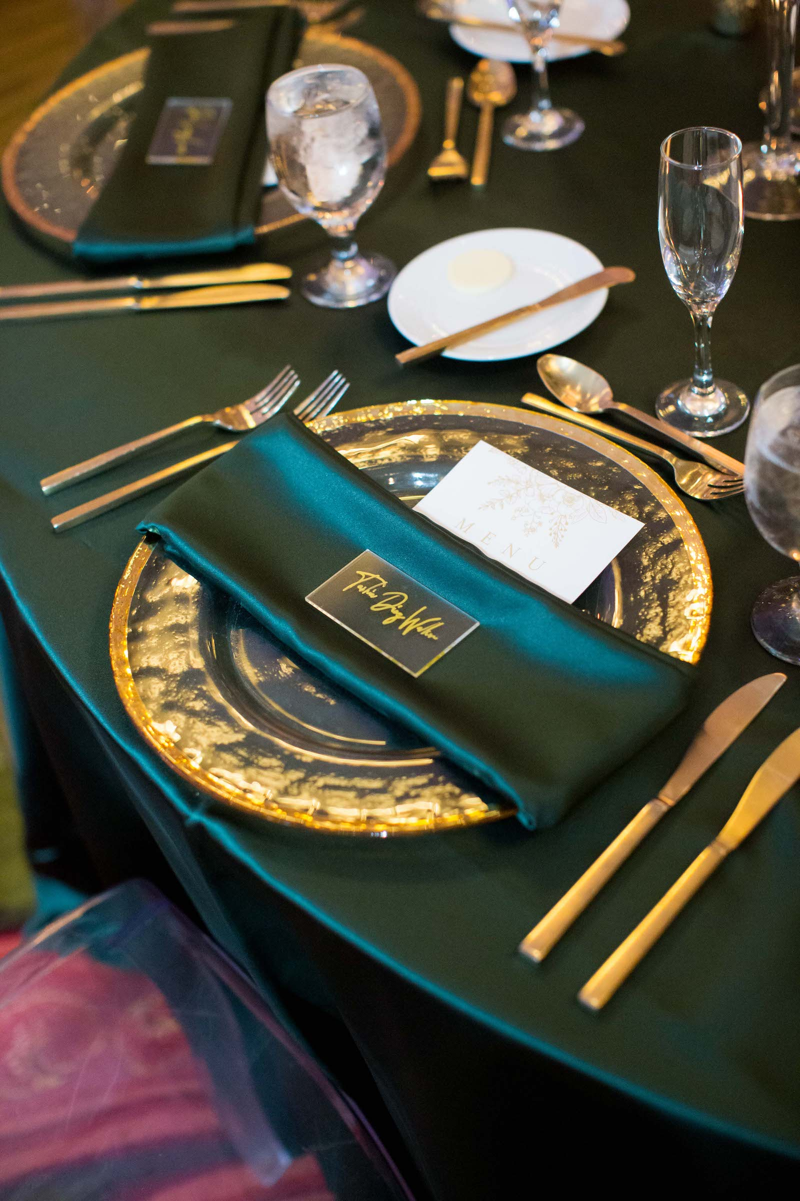 Elegant Wedding Reception Decor, Emerald Green Linens, Gold Chargers and Flatware, Acrylic Place Card | Tampa Bay Wedding Planner Parties A'la Carte | Wedding Rentals A Chair Affair