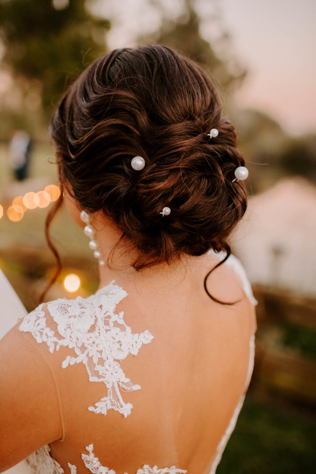 Loose Chignon Bridal Hairstyle Inspiration with Pearl Pins Sheath Illusion Lace Bridal Gown wedding Dress | Femme Akoi Beauty Studio