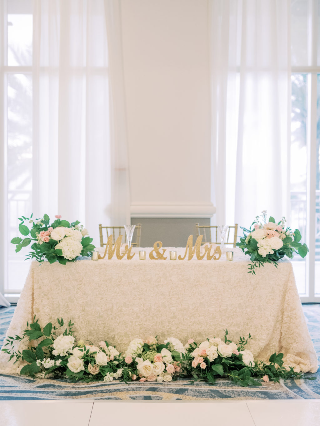 Timeless Romantic Sweetheart Table with Ivory Floral Linen, Lush Greenery and White, Blush Pink Roses and Hydrangeas, Gold Mr and Mrs Table Sign, Chiavari Chairs | Tampa Bay Wedding Planner Special Moments Event Planning | Wedding Rentals Kate Ryan Event Rentals | Wedding Venue Hyatt Regency Clearwater Beach