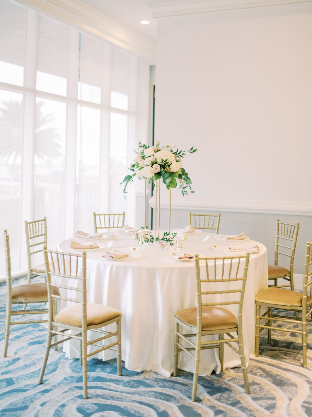 Timeless Romantic Wedding Reception Decor, Round Table with White Linen, Gold Chiavari Chairs, Tall White Floral and Greenery Centerpiece | Tampa Bay Wedding Planner Special Moments Event Planning | Wedding Venue Hyatt Regency Clearwater Beach | Wedding Rentals Kate Ryan Event Rentals
